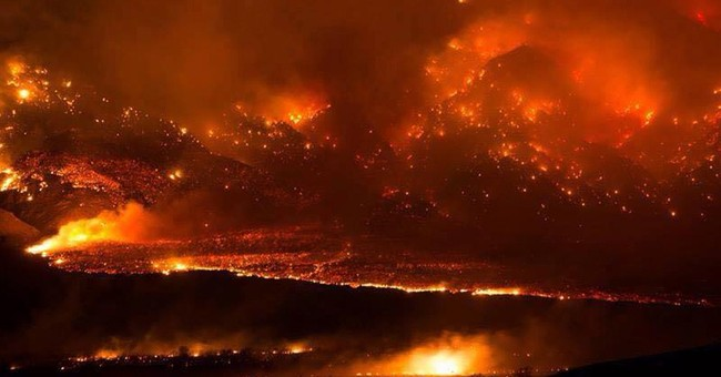Residents return to California towns charred by wildfire