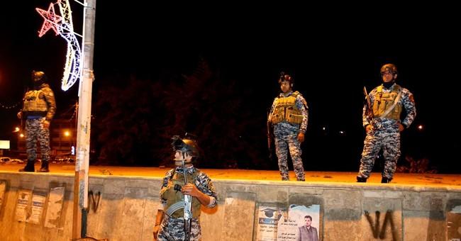 Suicide attack, bombing kill at least 22 in Iraq's capital