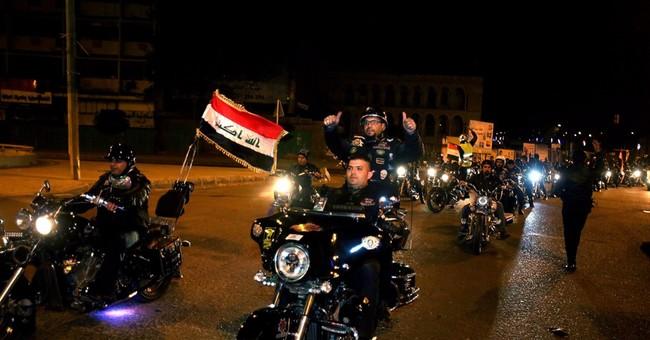 Ahead of curfew ending, bombs kill 40 in Baghdad area