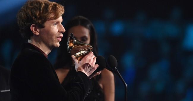 Kanye West almost pulls a Kanye on best album winner Beck
