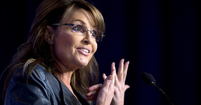Pic of Palin's son standing on dog draws reaction