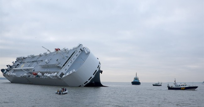8 missing after cargo ship capsizes off Scotland