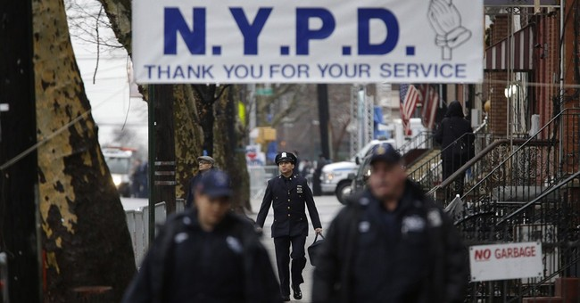 Mayor eulogizes officer as cops outside turn backs