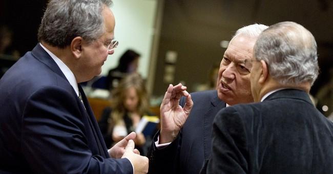 EU puts off new Russia sanctions, awaits Minsk peace talks