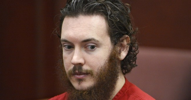 Defense in theater shooting case wants jail video barred