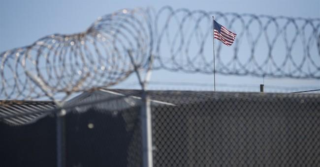 Interpreter's alleged link to CIA halts Guantanamo case