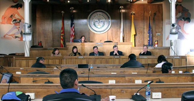 Lawmakers seek to wrap up costly tribal relocation program