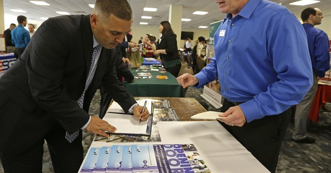 US job openings rise to 14-year high; job quits, hiring up