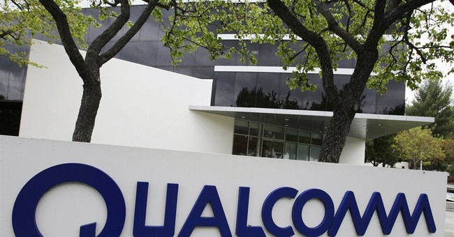 China fines Qualcomm record $975M in anti-monopoly case