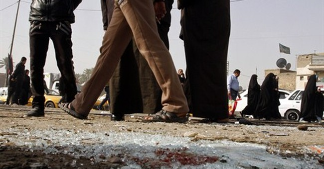 Officials say attacks outside Iraq's capital kill 8 people