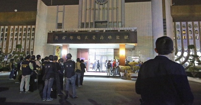 Official says hostage takers shoot selves in Taiwan prison