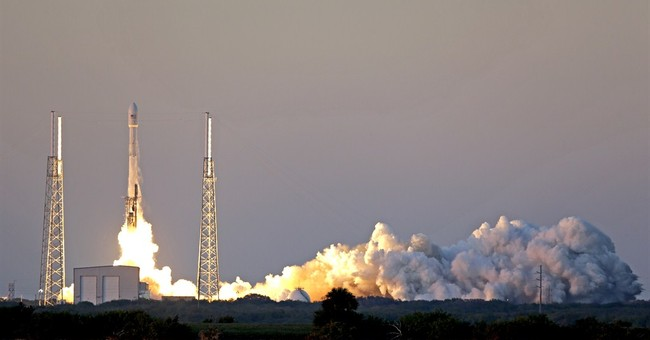 SpaceX launches observatory on 3rd try, nixes landing test