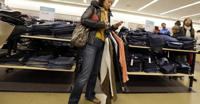 Cheaper gas lowers US retail sales; spending up elsewhere