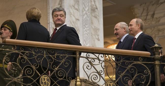 Marathon talks produce Ukraine peace deal; cease-fire Sunday