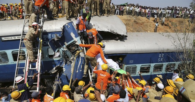 Train derails after hitting boulder in India, killing 11