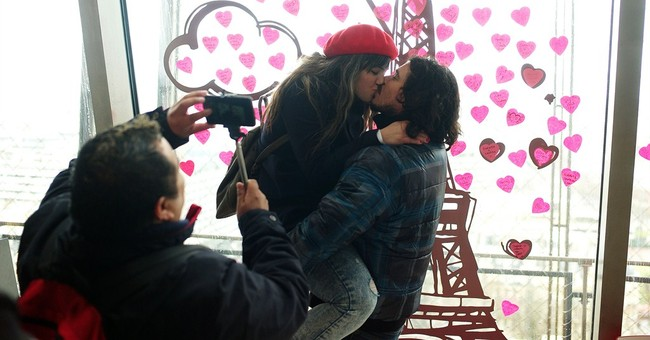 Couples seal their love at Eiffel Tower with heart post-its