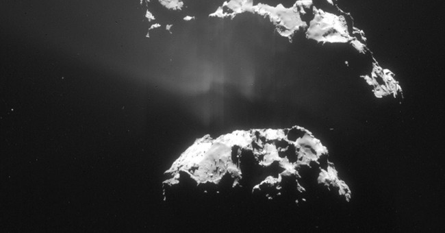 Europe's Rosetta craft swoops for close look at comet