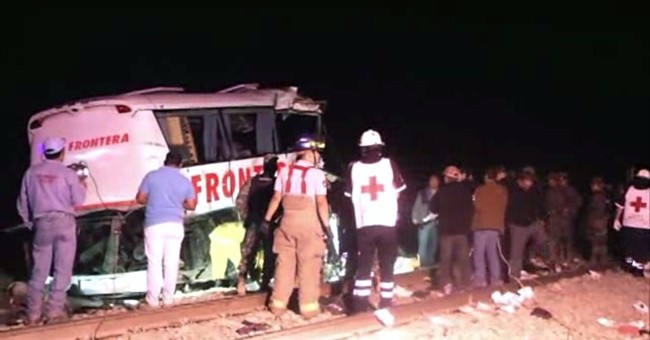 Death toll from bus-train crash in Mexico put at 20