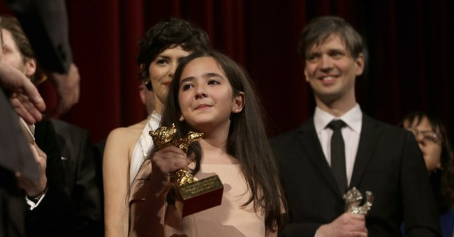 Iran director Panahi's 'Taxi' wins top honor at Berlin fest