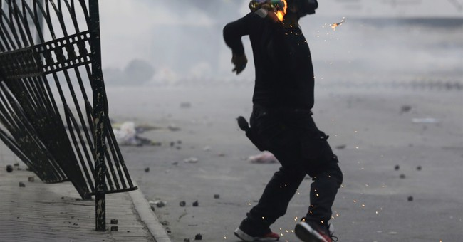 Bahrain activists rally, burn tires on uprising anniversary