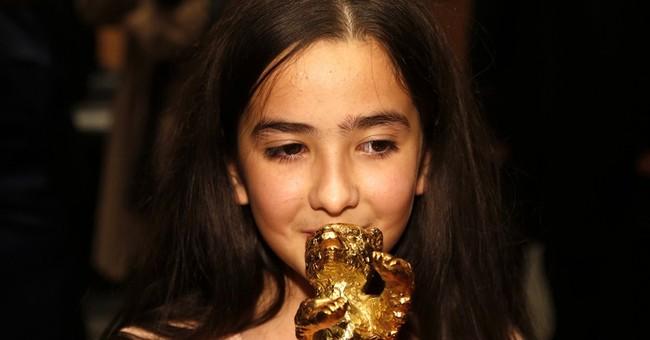 Iran director Panahi's 'Taxi' wins top honor at Berlin fest