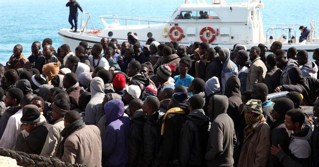 Armed migrant smugglers threatened Italian Coast Guard