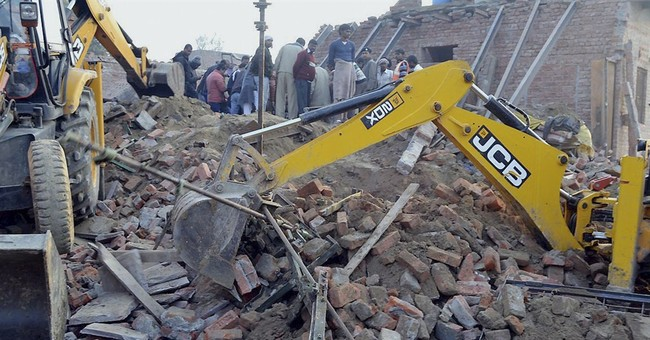 Building collapses in north India, killing 13 family members
