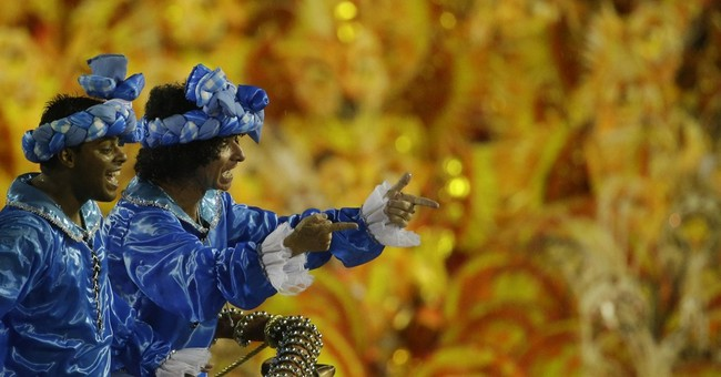 Carnival parades begin at Rio's Sambadrome, despite deluge