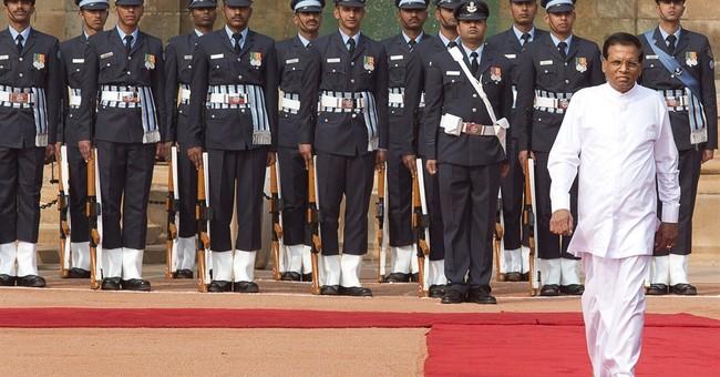 India's Modi talking with newly elected Sri Lankan president
