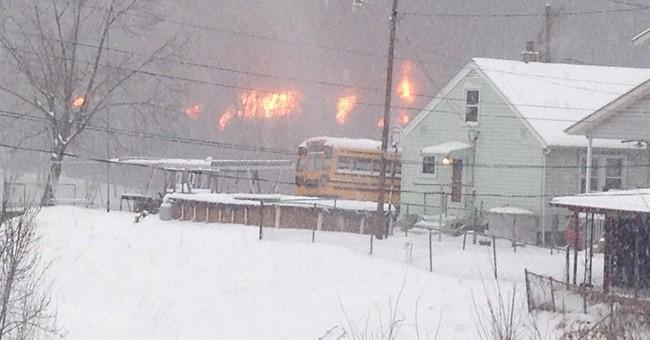 West Virginia train derails: Fires, oil tanker in river