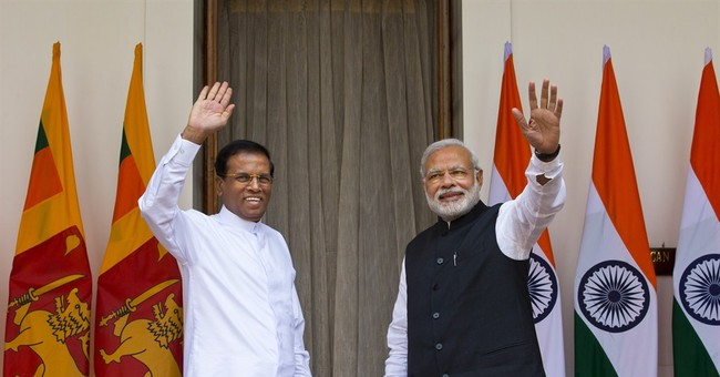 India's Modi talking with newly elected Sri Lankan president