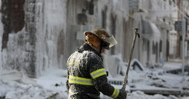 Philadelphia building coated in ice after fire in low temps