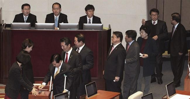 South Korean lawmakers approve new premier despite questions