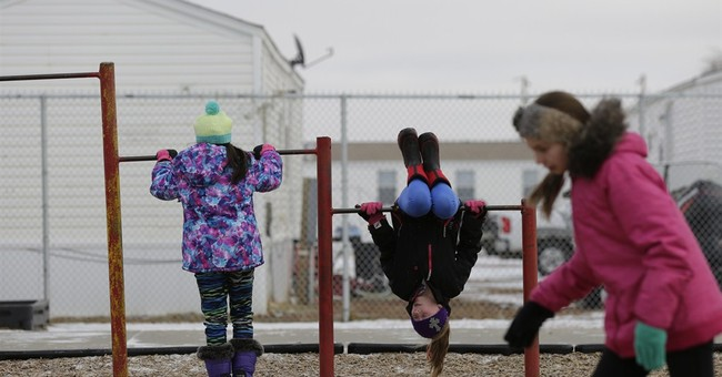 Growing pains: Oil boom turns prairie school to melting pot