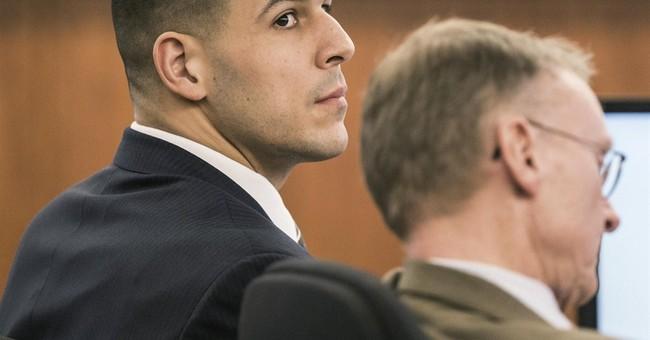 Video shows Hernandez dismantling phone day after killing