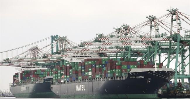 APNewsBreak: AP sources say port talks focus on arbitrator
