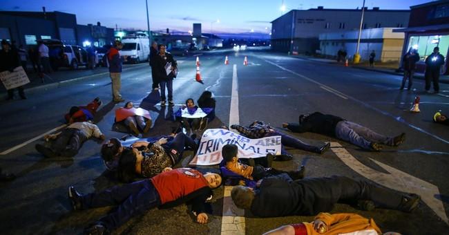 Hispanic group calls for federal probe of police shooting