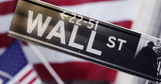 US stocks eke out another record high; Goodyear gains