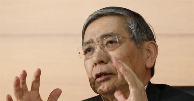 BOJ says economy on mend, keeps ultra-loose monetary policy