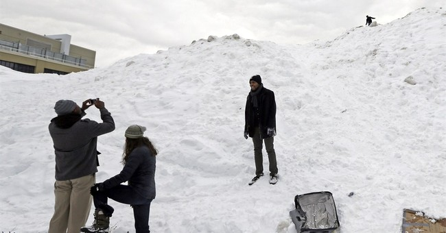 Snowbound Bostonians jump out windows, scale snow mountains