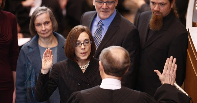 Kate Brown sworn in as Oregon governor; predecessor resigns