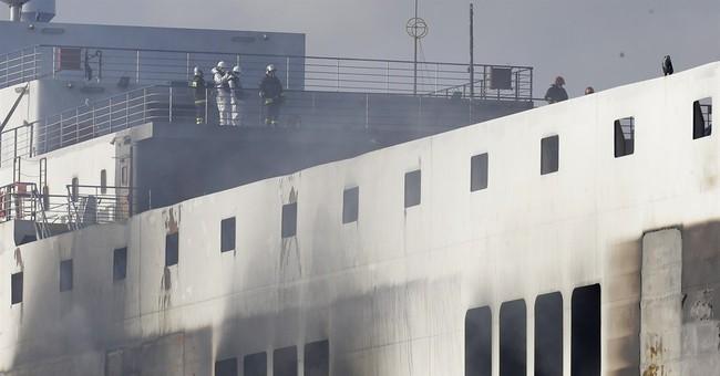 Fierce heat on charred Greek ferry slows search for bodies