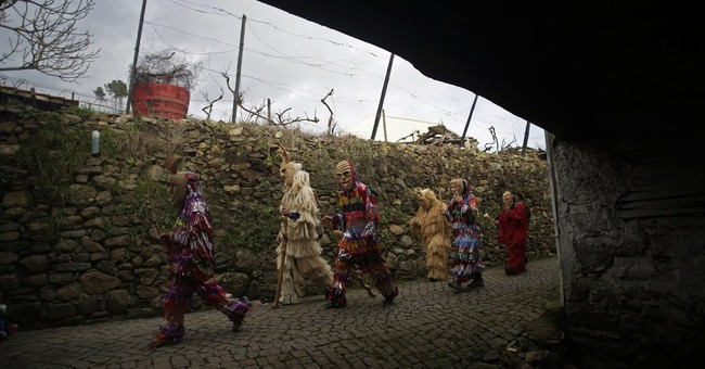 AP PHOTOS: Spanish, Portuguese towns celebrate Carnival