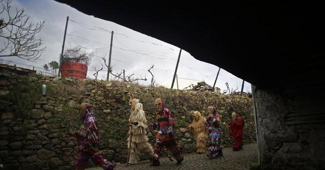 AP PHOTOS: Spanish, Portuguese towns celebrate Carnival