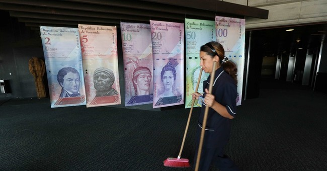 Venezuela allows sale of dollars at near-black market rate