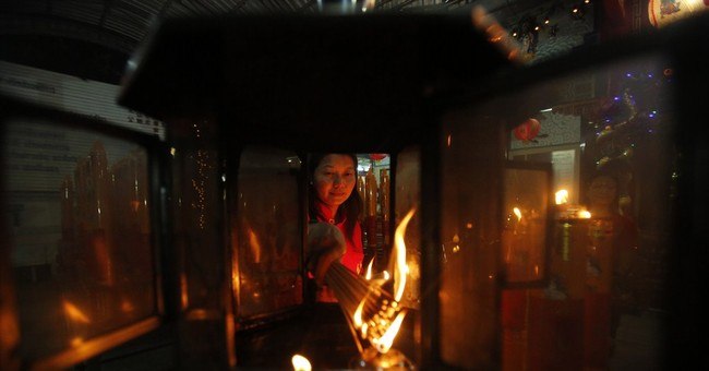 AP PHOTOS: Fireworks, prayers usher in Lunar New Year