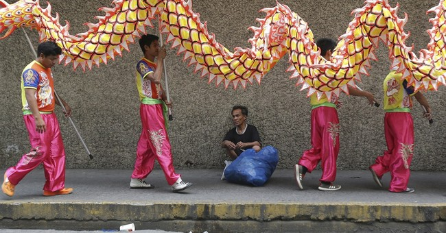 Chinese lions, dragons family business for Filipino siblings
