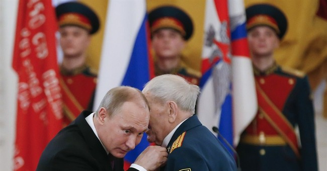 Putin says Russia will never yield to foreign pressure