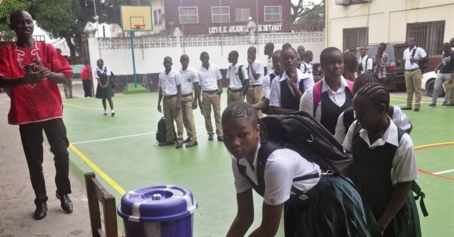 Liberia to end Ebola curfew, open land border crossings