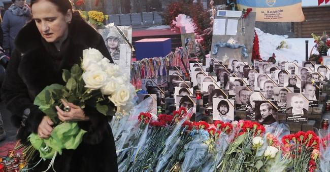 Troubled Ukraine marks year since protest bloodbath in Kiev